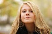 Beautiful blonde in autumn winter coat — Photo