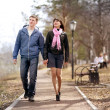 Lovers walking in the park — Stockfoto