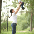 Happy young mother playing with baby in the park — Stock Photo