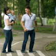 Happy young family mom dad and baby in the park — Stock Photo #36344105