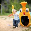 Stock Photo: Little boy playing on the playground