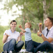 Happy young mother playing with baby in the park — Foto de Stock