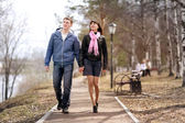 Lovers walking in the park — Stock Photo