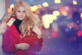 : Fashion girl walking at night in winter. shopping theme — Stock Photo