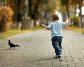 Cheerful little boy in the park — Stock Photo