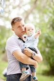 Little boy playing in the park with dad — Stock Photo