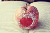 Apple with heart symbol — Stock Photo