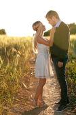 Lovers in wheat field — Stock Photo
