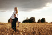 Woman on the man shoulders — Stock Photo