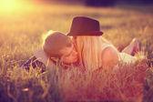 Lovers in field — Stock Photo