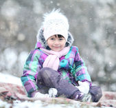 Child girl in the winter park — Stock Photo