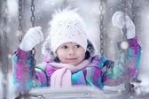 Child girl on swing — Stock Photo