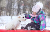 Girl with white dog — Stock Photo