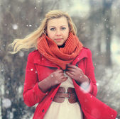 Woman in red coat — Stock Photo