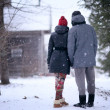 Lovers in winter village — Stock Photo