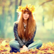 Woman with maple leaves wreath — Stock Photo