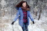 Girl jumping in snow — Stock Photo