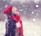 Girl in snowy winter forest — Stock Photo
