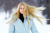 Blond girl hair fluttering — Stockfoto