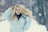 Blond girl hair fluttering — Stock Photo