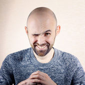 Wink man with a beard — Stock Photo