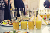 Restaurant serving juice and champagne — Stock Photo