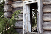 Old wooden destroyed house — Stock Photo