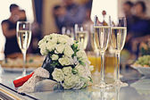 Champagne with bouquet — Stock Photo