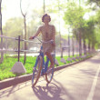 Girl with bicycle in park — Stock Photo #47618013
