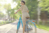 Girl with bicycle in park — Stock Photo