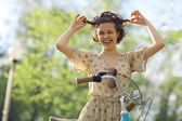 Funny  Girl with bicycle — Stock Photo