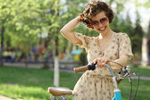 Happy Girl with bicycle — Stock Photo