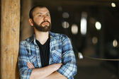 Bearded  man in attic — Stock Photo