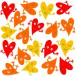 Yellow orange red smiling hearts on white background seamless pattern — Stock Vector