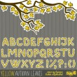 Latin alphabet yellow messy leaves big letters and signs autumn set isolated on dark patterned background — Stock Vector