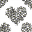 Seamless daisies heart shape pattern — Stock Vector #48446473