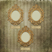 Old gold frames Victorian style on the background — Stock Photo