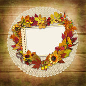Stamp-frame with autumn leaves on a wooden background — Stock Photo