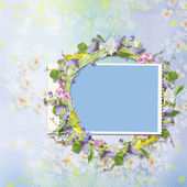 Frame with a wreath of flowers on a beautiful background — Stock Photo