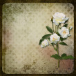 Royalty-Free Stock Photo: The branch of roses on a vintage background