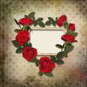 Frame with a wreath of roses on vintage background — Stock Photo