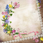 Flowers on the vintage background with lace — Stock Photo