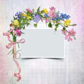 A bouquet of flowers with a frame on the vintage background — Stock Photo