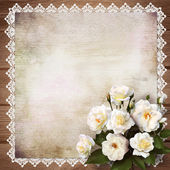 Bouquet of roses on a vintage background — Stock Photo