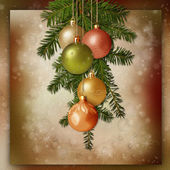 Christmas balls and spruce branches on a vintage background — Stock Photo