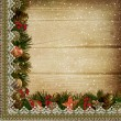Stock Photo: Borders with Christmas decorations and lace on the wooden background