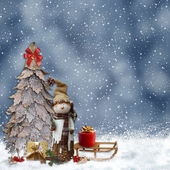 Winter background with a snowman and Christmas trees — Stock Photo