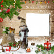 Christmas decoration with snowman, gift bag and a card on a wooden background — Stock Photo #35043435