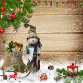 Christmas decoration with snowman and gift bag on a wooden background — Zdjęcie stockowe