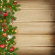 Christmas miraculous garland on a wooden background — Stock Photo #35556117